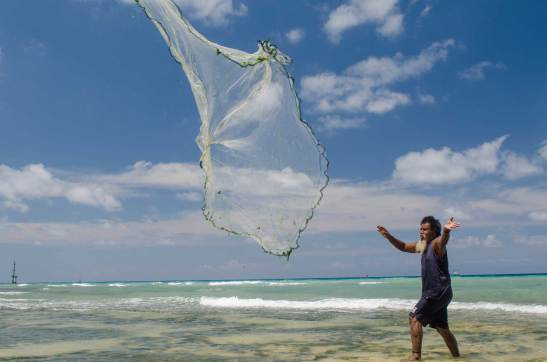 A local Papuan casts his net in an attempt to catch fish. Photo by conservation photographer and cultural photographer Pete Oxford.