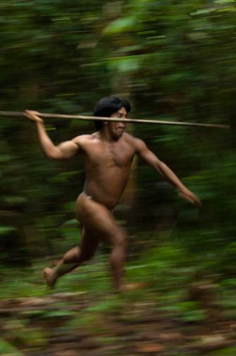 A native Namo Yate hunts with a lance in Yasuni National Park. Photo by conservation photographer and cultural photographer Pete Oxford.