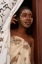 A woman shows her Sakalava face mask. Photo by indigenous person photographer Pete Oxford.