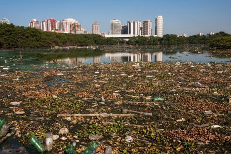 A large amount of garbage floats on the surface of the river by Rio de Janeiro. Photo by conservation photographer Pete Oxford.