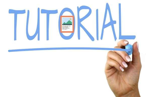 """Das Bild """"Agamotto als Tutorial"""" zeigt eine transparente Flipchart mit einer Hand, die das Wort """"Tutorial"""" schreibt. Im 'o' von """"Tutorial"""" ist das Logo vom H5P Inhaltstyp Agamotto eingefügt."""