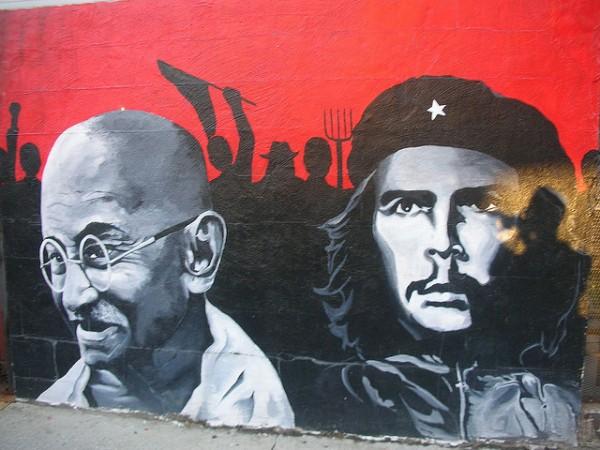 Ghandi and Guevara painted as graffiti on a wall