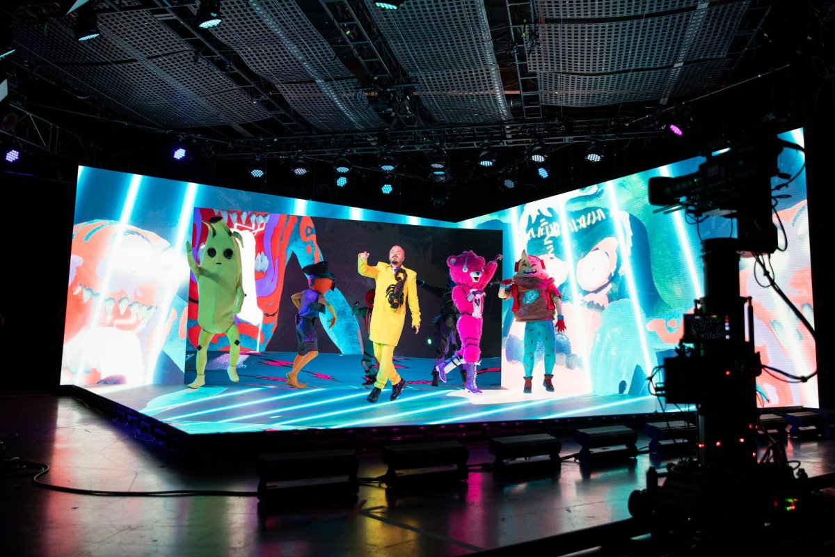 J Balvin in a virtual studio with dancers dressed in Fortnite skins