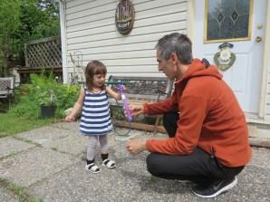 Richard explaining the Bubble Blower to Emeline