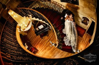 Bride and groom posing on stairs