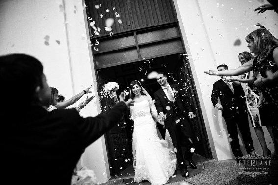 London wedding photographer - bride and groom confetti