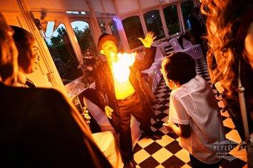 Documentary wedding photographer London magician performs