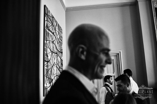 Documentary wedding photographer London St pancras hotel men coming in