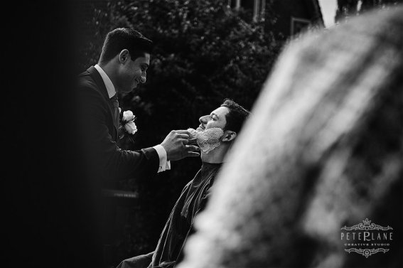 Documentary wedding photographer Barnet greek groom shaved