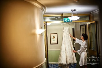 Documentary wedding photographer London - bride fixing wedding dress