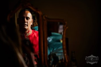 Indian Wedding Photographer London - groom in the mirror