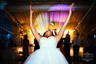 Greek wedding photographer Barnet bride tossing bouquet