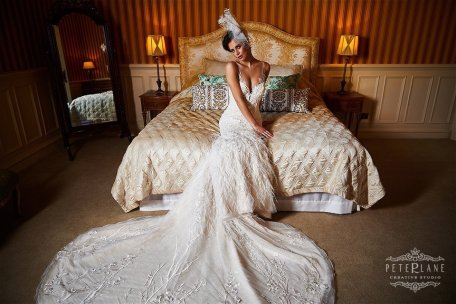 Wedding photographer Luxury bride sits on bed