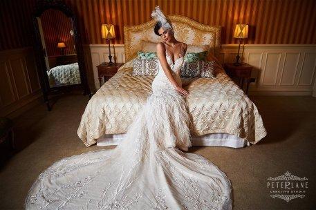 Wedding photographer Luxury bride sits on bed