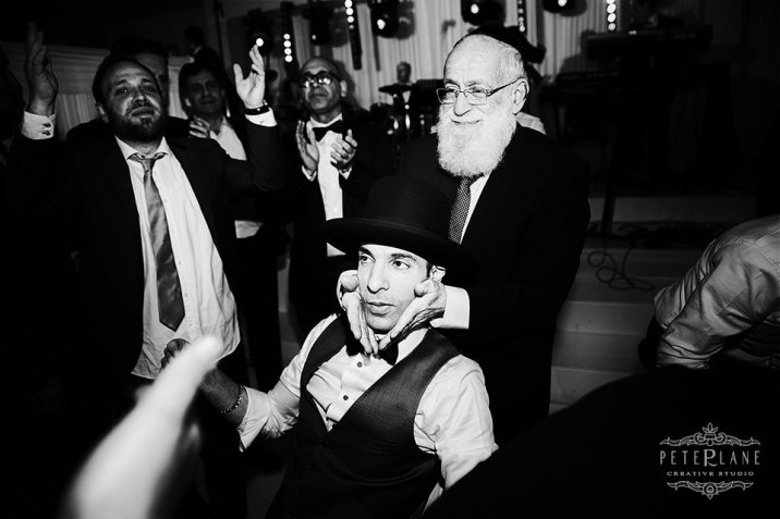 jewish wedding photographer London groom with rabbi