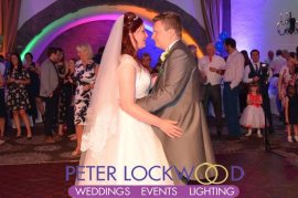 wedding first dance with rainbow wedding lighting