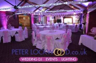 pink-wedding-lighting-in-the-horseshoe-suite-at-the-bolholt-bury