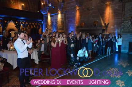 wedding-guests-watching-the-first-dance-routine-in-peckforton-castle