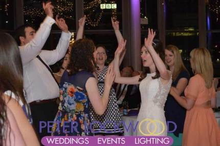 bride-and-friends-dancing-at-her-wedding-in-the-Compass-Room