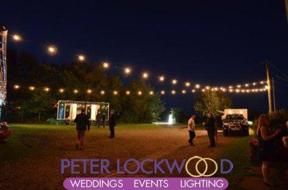 outside the wedding barn lighting