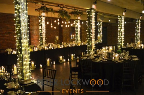 victoria warehouse wedding edison lighting fairy lights and candles