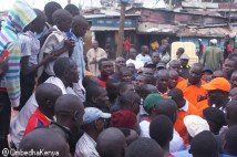 Kibra Member of Parliament listening to one of the residents during his tour on Monday 11th May 2015. This was his first tour in the area since he was elected as the area member of parliament on 3rd March 2013 post