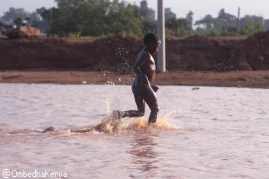 This young boy was swimming at one of the rivers in Langatta, just a neighboring to Kibera. This river was made by constructors who used to work at Southern Bypass.