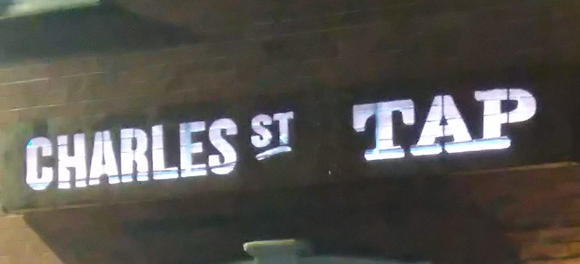 Charles St Tap back lit sign