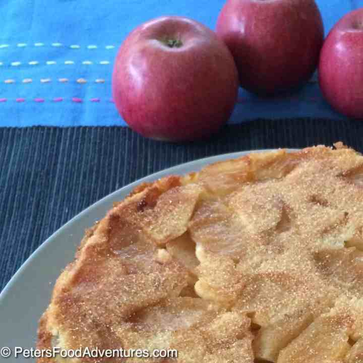 This is the best Russian Apple Cake recipe. It's light, fluffy, moist and delicious. Not an apple pie, but a cake sprinkled with cinnamon sugar - Rita's Sharlotka Apple Cake (Шарлотка)