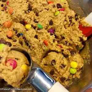 Everything You Want in a Cookie! Oats, Smarties, Chocolate Chips, Peanut Butter! A classic American cookie! This large batch recipe makes enough to feed a small army! Easy Monster Cookies Recipe