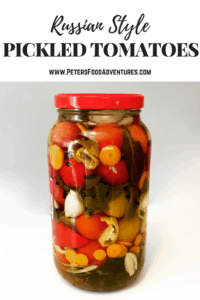 Enjoy your fresh, garden tomatoes by preserving them Russian-style. Pickled Tomatoes (солёные помидоры) with garlic and fresh herbs. I stuff extra veggies between the tomatoes. These canned tomatoes are a staple year round.