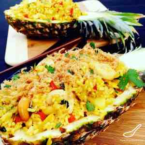 Authentic Thai Pineapple Fried Rice served inside a pineapple! Easy to make and delicious!