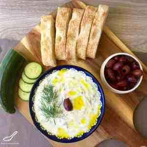 This authentic Tzatziki sauce is so easy to make, gluten free and tastes delicious. Made with Greek yogurt and cucumbers, its a mediterranean classic. Homemade Easy Tzatziki Recipe