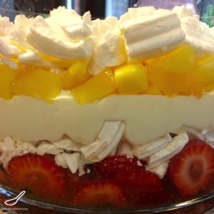Super easy to make, a modern trifle, without the boring stuff! Meringue, cream, passionfruit, mangoes and strawberries, topped with white chocolate - heaven in a bowl! Favourite at Christmas holidays and Thanksgiving - Easy Pavlova Trifle Recipe