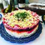 A classic Russian winter recipe, popular especially during New Year celebrations. A layered salad with beets, potatoes, carrots, eggs, herring and lots of mayonnaise! It's like a crazy potato salad! - Shuba Salad or Herring Under a Fur Coat (Селёдка под шубой)