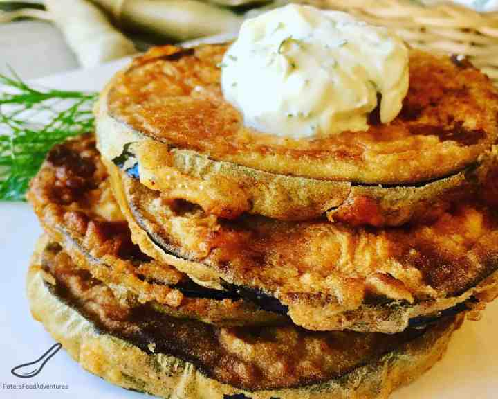 Fried Eggplant Slices are a quick and easy appetizer or side dish, aubergine slices fried in oil then slathered generously with sour cream and fresh dill - Fried Eggplant Slices (Жареные баклажаны)