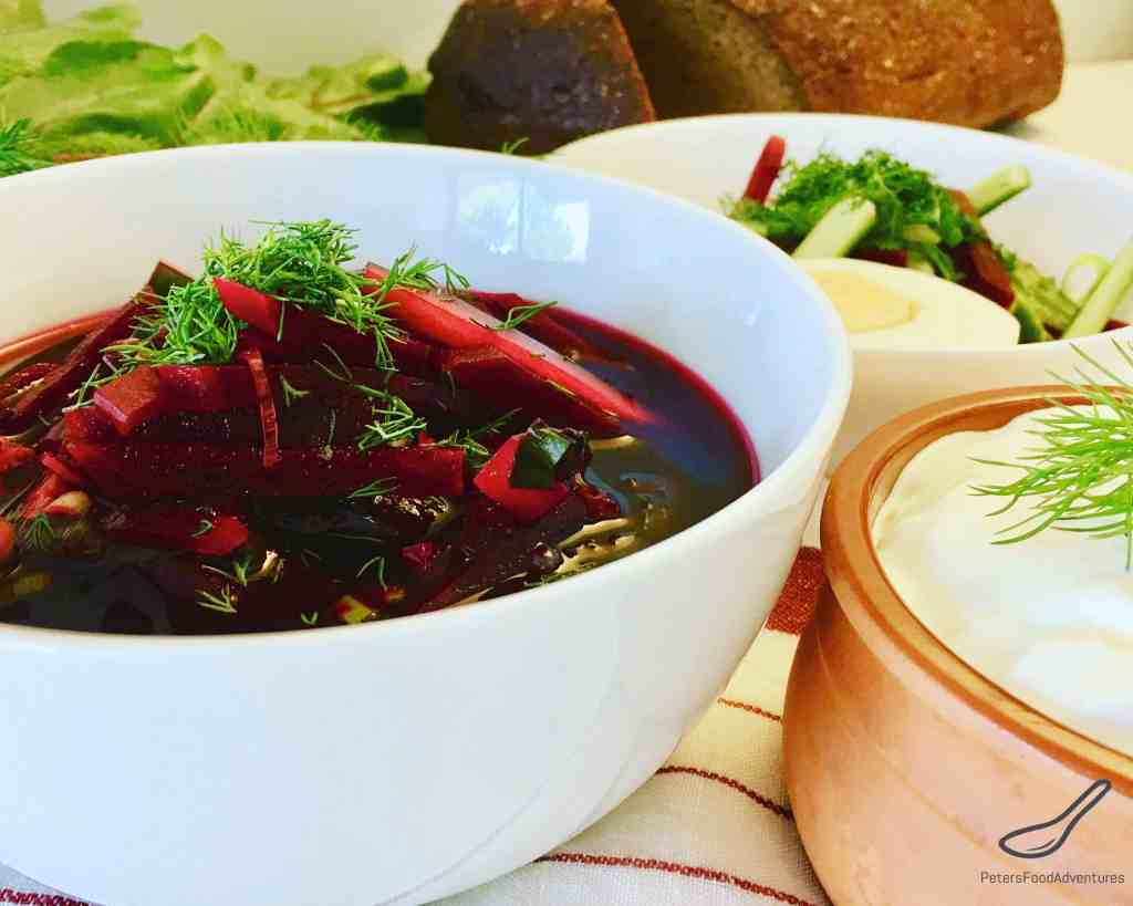 Cold Beet Soup in a bowl with sour cream and rye bread
