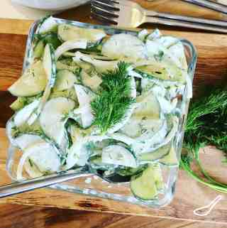 Mizeria - Creamy Cucumber Salad is super easy to make, only takes minutes, and so delicious. This Eastern European classic has roots in Poland. The simple cucumbers and sour cream salad with fresh dill and onions is a perfect summer salad.