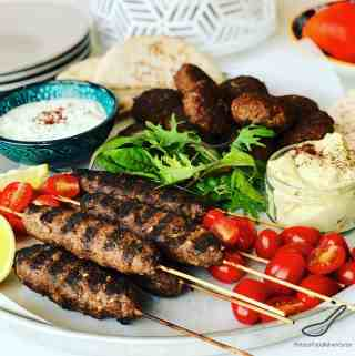 A delicious grilled Greek Mediterranean classic with ground lamb, cumin ,coriander, sumac served with pita bread and Tzatziki sauce -Easy Lamb Kofta Kebabs Recipe