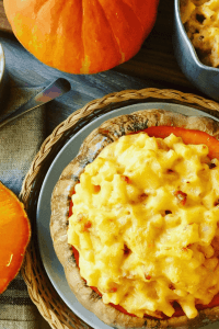 Baked Pumpkin Mac and Cheese with Bacon is easy to make, super cheesy and a healthier way to enjoy this American Dinner favorite. A perfect fall comfort food, especially around Halloween.