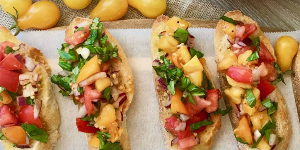 The secret to making a delicious Summer Bruschetta is to use garden fresh ripe tomatoes. It's so easy to make, jam packed with flavour from garlic, onions basil and balsamic vinegar, This is the best bruschetta I've eaten! Bruschetta with Tomato & Basil