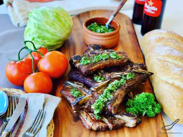 Grilled Beef with Chimichurri on a dinner table