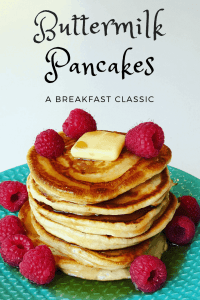Buttermilk Pancakes stack with fresh raspberries and syrup