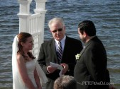 Pastor Ralph presides over Dan and Crystal's wedding ceremony.