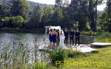 Outdoor ceremony space on the pond at Wolf Oak Acres in Oneida, NY