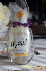 Favors consisted of minature wine glasses with a mini bottle of wine inside! Each table was named after a different type of wine, rather than numbers.