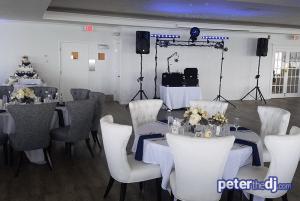 Indoor wedding reception DJ setup for Chris and Ashley's wedding at Lake Shore Yacht & Country Club, Cicero, NY.