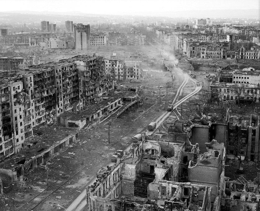 Grozny, Chechnya, March 1995. A Russian military column makes its way through the ruined city centre after rebel forces retreated from the city in the face of the Russian bombardment.