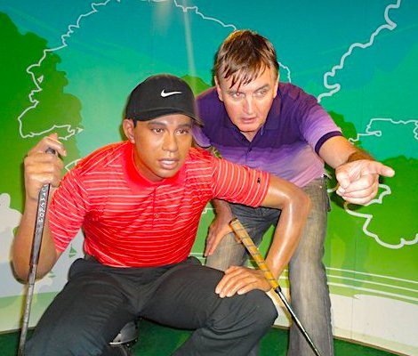 Peter Zapfella helping Tiger Woods with a difficlut shot.