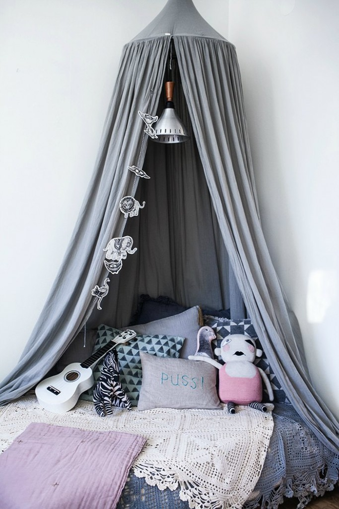 grey bedroom chair next white covers and sashes a bohemian chic kids' room - petit & small